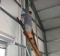 Tramway Works Manager Craig at work wiring the new shed.